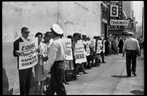 Unseen civil rights photos 63-2825 Norman Dean photo Integration Movement Sit in demonstrations (Wednesday April 10 1963) 35 mm frame 8 Jazz Singer Al Hibbler picketing in front of Trailways depot at 4th and 19th. Police refused to arrest Hibbler with 25 other demonstrators, and instead drove him back to the Gaston Motel. The same day, 13 Miles students peacefully integrated the downtown Public Library.